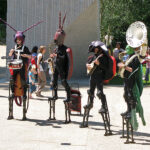 Insect musicians led a colourful parade of children
